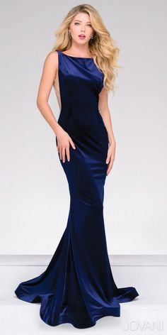 Look like royalty in the sultry Plunging V-back Fitted Velvet Evening Dress by Jovani. This one of a kind style features a bateau neckline, a sleeveless bodice, a plunging v-back and an invisible zipper down the center. The fitted silhouette also includes beautiful velvet fabric, mesh cutouts at the sides and a flared bottom for a show stopping finish. #edressmei