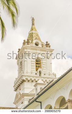 Low angle view of one of the towers of the ancient San Franciso catholic church located in the historic center of Quito in Ecuador.