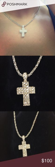 Swarovski Cross Necklace Swarovski Cross Necklace. Like new no missing stones or discoloration. Comes with Swarovski pouch also. Swarovski Jewelry Necklaces