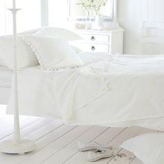 White pom pom cushion
