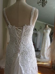This is a handmade, one of a kind gown. On sale more than 50% OFF original price of $1,295. The lace is an off-white/light ivory and has been