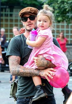 David Beckham carried daughter Harper — rocking a pair of baby Doc Martens! -- as they hit a playground.