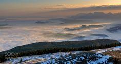 Morning above Karnten by edvardstorman-badri  Austria Dobratsch Karnten clouds fog forest light mist morning mountain sky snow sunrise trees winte