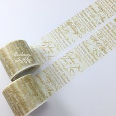 Gold Calligraphy Washi Tape. This tape is perfect for all paper projects! Use as a border to make unique scrapbook pages! This tape has the perfect amount of adhesive; letting the tape hold firm when