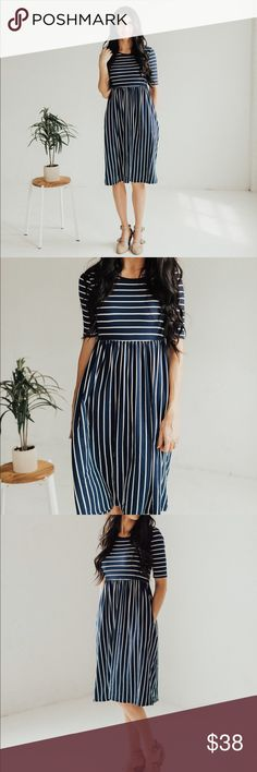 Striped Midi Dress with Pockets - Navy/Ivory Half sleeve with horizontal and vertical stripes. Pockets! I am 5'9 wearing a size small. Small (0-4) Medium (4-8) Large (8-12) X Large (12-16). 95% polyester 5% Spandex Dresses Midi