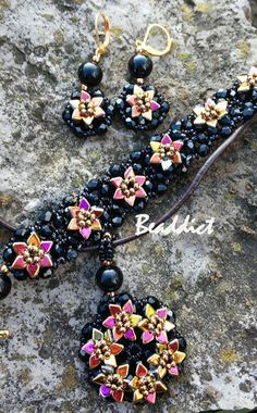 """""""Dragon Scale Flowers"""" set of earrings, bracelet and pendant. Designed and beaded by Beaddict. Seed beads, fire polished beads, dragon scale beads."""