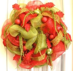 Learn to make gorgeous mesh wreaths for yourself, to give as gifts or to sell online. My ebook has helped so many people to make hundreds o...