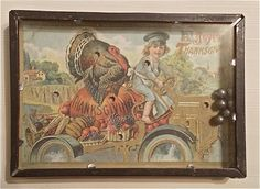 """Dexterity Game Puzzle Thanksgiving. 5  X  3-1/2"""" vintage frame with marriage of vintage Thanksgiving postcard with holes in it for metal balls to fall into.  Glass front and cardboard back.  This was crafted by Bethany Lowe Designs  from the Bruce Elasse Vintage Collection. Vintage old postcard with boy riding a tractor like car filled with a huge Thanksgiving Turkey, pumpkin and loads of veggies from the garden."""