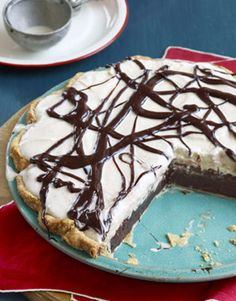 Mississippi Mud Pie... a mouthwatering pie with a layer of chocolate custard, vanilla ice cream, and a drizzle of rich fudge sauce.