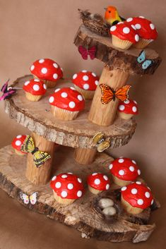 Toadstool cupcakes on a natural cake stand.