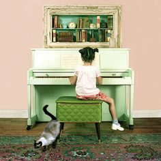 cute..practicing the piano and her lil kitty :)