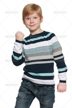 Success of a young boy ...  alone, boy, caucasian, cheerful, child, childhood, confident, cut out, cute, emotion, emotions, enjoyment, european, fashion, fist, fist up, fun, gesture, handsome, happiness, happy, indoor, isolated, joy, kid, one, people, person, pleasure, portrait, positive, positivity, red, red hair, red-haired, shirt, single, smile, stand, studio, success, white, young