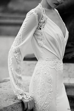 GORGEOUS for a vintage wedding gown! I love the sleeves and the neckline, and am amazed that it has so much detail work, and yet still looks simple and not flashy!