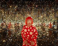 The artist, Yayoi Kusama photographed in one of her Fireflies on the Water art exhibits.