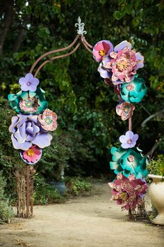 Giant paper flower garden arch using Japanese chiyogami yuzen washi paper mixed with colorful craft papers to make the designs pop www.TheRareOrchid.com