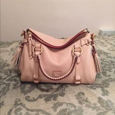"""Dooney bourke small florentine satchel in """"Bone"""" French vanilla color with yellow undertones. No pink tones. SMOOTH leather. This this the small of the vachetta florentine. Used for 3 days. Like new condition. Too beautiful to carry. Dooney & Bourke Bags Satchels"""
