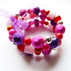 Bracelet perles de verre, métal et résine...