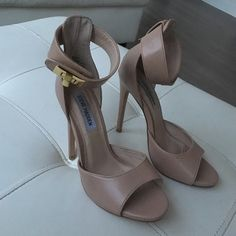 Steve Madden Twist-Lock Ankle Strap Heels Worn twice heels do have one small scratch mark per shoe on actual heel area (as shown in photos) but can easy be fixed by a cobbler... Shoes are beautiful and in great shape other than that.... Ready for a new home Steve Madden Shoes Heels