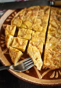 Spanish Tortilla...a classic Tapa to go with a fruity white #wine like Macabeo  Beso de Vino Macabeo