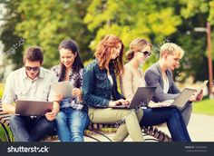 Summer, Internet, Education, Campus And Teenage Concept - Group Of Students Or Teenagers With Laptop And Tablet Computers Hanging Out Стоковые фотографии 190342868 : Shutterstock