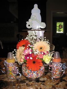 the vase with flowers and sprinkles is cute...don't know how I feel about the baby bottles (?)