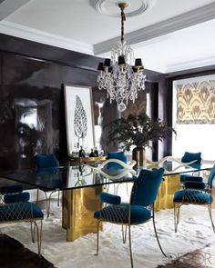 Sophisticated glamour for a formal dining space with black lacquered walls, stunning crystal chandelier, glass table with gold feet and ornate chair in teal velvet. … Read More