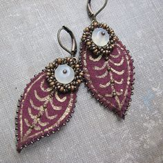 love this idea for using ultra suede embellished with paint pens and bead work