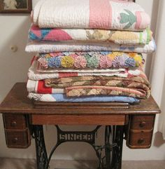 Pieceful Afternoon: article on re-folding quilts to avoid creases, fading
