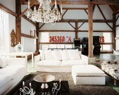 lounge room + white couches + chandeliers  + timber. add some over sized paintings and this is perfect.