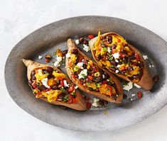 Supercarb Loaded Sweet Potatoes: Move the heck over loaded nachos. Black bean, roasted pepper and feta cheese packed sweet potatoes are here to satisfy your cravings. Click through for more sweet potato recipes you'll love any time of year. Savory Sweet Potato Recipes, Good Sweet Potato Recipe, Loaded Sweet Potato, Veggie Recipes, Vegetarian Recipes, Cooking Recipes, Veggie Meals, Yummy Recipes, Recipies