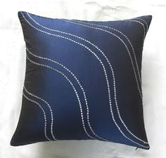 http://www.etsy.com/listing/60684093/navy-blue-throw-pillow-w-silver-wave?ref=fp_feat_1