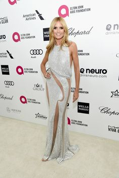 Heidi Klum Cutout Dress - Heidi Klum put on a seductive display at Elton John's Oscar-viewing party in a glittery silver Atelier Versace gown with groin-and-leg-baring cutouts. Heidi Klum Model, Celebrity Dresses, Celebrity Style, Celebrity Gossip, Versace Gown, Elton John Aids Foundation, Oscar Dresses, Nice Dresses, Formal Dresses