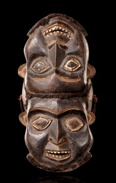 Africa | Head crest with two heads from the Bamileke people from the Cameroon Grassfields | Wood with blackish brown patina, and real hair
