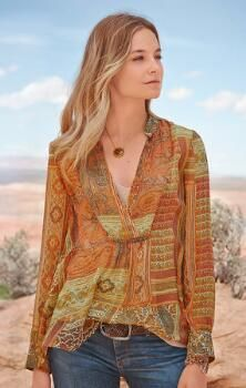 You'll love the delicate accents on this stunningly romantic mixed print V-neck top.