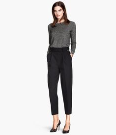 Black high-waisted suit pants with wide, tapered legs & pleats at top. Adjustable belt with metal side buckles. | H&M Modern Classics