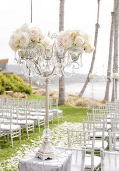 glamorous vintage wedding beach ceremony aisle decorations  This could be made as a DIY project with a painted chandelier from thrift store painted upside down, add the china to put flowers and top in on a spindle and block from Home Depot or Menards Add crystals and beads... Similar to the DIY backyard lamp posts but jazzed up for wedding style