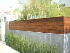 contemporary front fence design - smooth stucco and Ipe wood fence Wood Fence Design, Modern Fence Design, Concrete Design, Modern Wood Fence, House Fence Design, Rustic Fence, Backyard Fences, Backyard Landscaping, Fence Garden