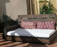 A patio day resting bed made from pallets
