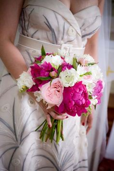 Bridal bouquet of Raspberry Peonies, white Freesia, white Sweet Peas and pink English Garden Roses gathered with a white organza ribbon and bow for an Intimate and farm fresh daytime wedding {Design: TableArt | Photo: Susan Beard Design}