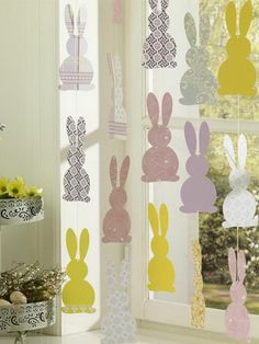 Easter garlands yourself make colored paper rabbits cut