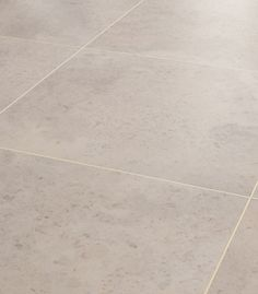 Karndean Opus Nimbus vinyl flooring has a clean, smooth stone effect almost parallel to a porc