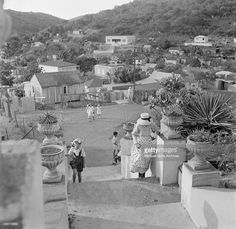 A view as a women and little girl walk up stairs in Charlotte Amalie, St. Thomas, US Virgin Islands.