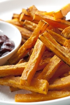 This is a fantastic recipe and the fries are so tasty. Sweet potatoes are flavored with salt, cinnamon and garlic and then baked in a hot oven until they are soft inside and golden brown on the outside. A little cornstarch is used to get them really crispy. You can omit the cornstarch if you do not have any, but it does give the fries extra crunch.