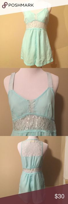 Urban Outfitters Intimates-Romper w/Lace Detail Beautiful lingerie romper with elastic tank straps and sheer lace detail around waist and part of back. Labeled as size M but fits more like size S. Zip side closure. Made by Pins & Needles (purchased at Urban Outfitters); never worn! Pins & Needles Pants Jumpsuits & Rompers