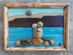 """Pebble Art Family of Three (Parents and Child/Baby) by the Lake or Ocean set in an """"open"""" rustic 5x7 wood frame by CrawfordBunch on Etsy"""