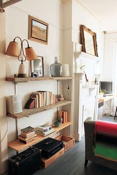 Rustic plank shelving. Visually occupies much less space than a standard bookshelf, with a unique charm.