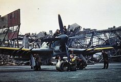 Ground personell working on a Hawker Typhoon Mk Ib at an occupied airbase in Europe.These powerful aircraft were employd during the invasion of Europe in and created havoc amongst rail convoys and ground installations with their rockets. Ww2 Aircraft, Military Aircraft, Hawker Tempest, Hawker Typhoon, Hawker Hurricane, Ww2 Planes, Vintage Airplanes, Royal Air Force, World War
