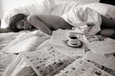 Lazy mornings in bed.. newspapers and tea