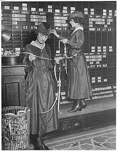 On this1918 photo by Underwood & Underwood, young women operate the Waldorf-Astoria Hotel's Stock Exchange Board, reading tickers and manually adjusting numbers. The Waldorf had several years earlier shown a progressive attitude toward women when it reportedly became the first upscale NYC hotel to allow women to stay in its rooms without an escort. Two years after this photo was taken, the Nineteenth Amendment was ratified, and U.S. women had won the vote.