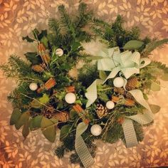 Large spruce, holly and eucalyptus wreath with thyme and cinnamon for added scent. Green gingham cascading bow and sparkly white baubles. Christmas 2016, Christmas Wreaths, White Baubles, Eucalyptus Wreath, Textile Design, Gingham, Cinnamon, Bow, Table Decorations